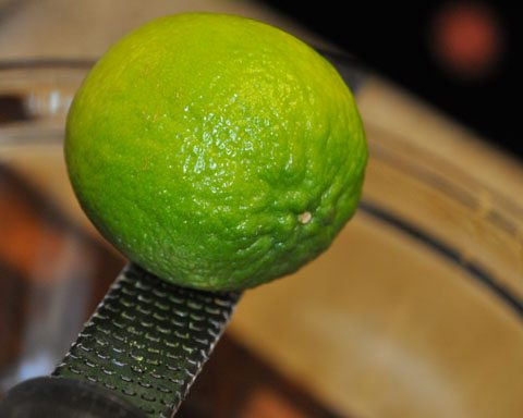 Zest and juice 2 limes in a medium sized bowl.